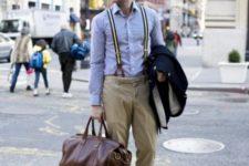 With blue shirt, pants, black boots and brown big bag