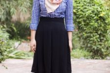 With checked shirt, knee-length skirt and ankle boots