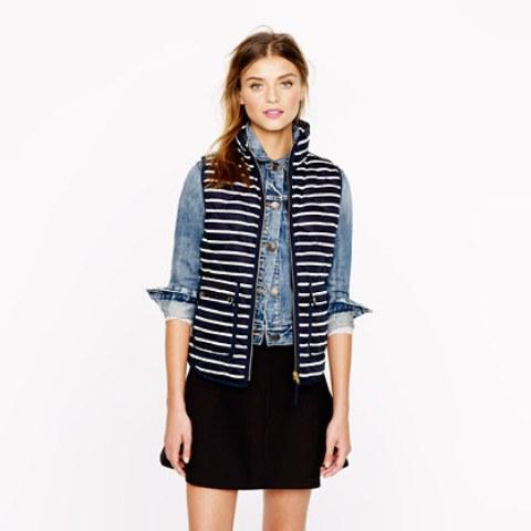 With denim jacket and black mini skirt