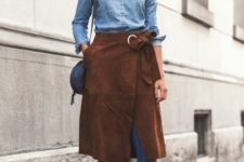 With denim shirt, jeans, sandals and navy blue bag