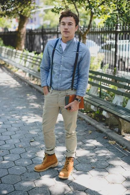 With denim shirt, white t-shirt, cuffed pants and brown boots