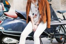 With floral blouse, white jeans and suede ankle boots