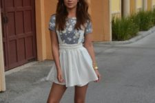 With floral shirt and white sandals