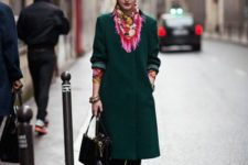 With green coat, platform boots and small bag