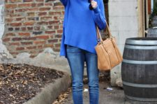 With jeans, gray boots and brown bag