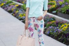 With light blue shirt, floral pants and bag