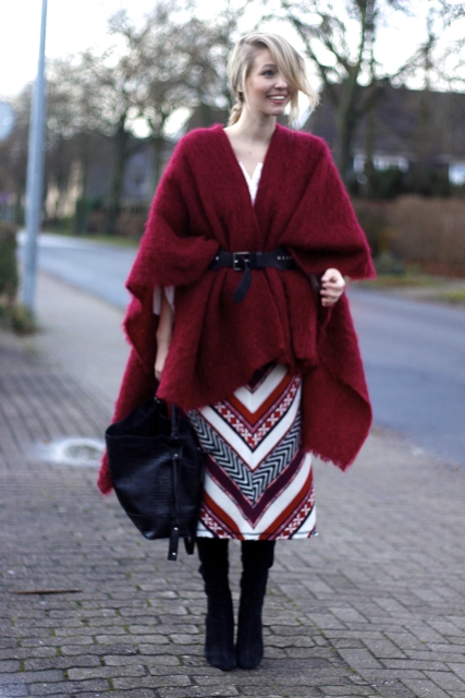 With marsala cape, high boots and black bag