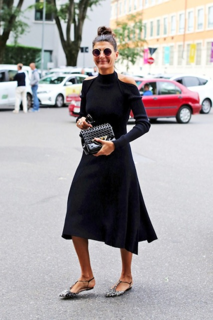 With midi dress and clutch