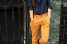 With navy blue blouse and brown suede boots