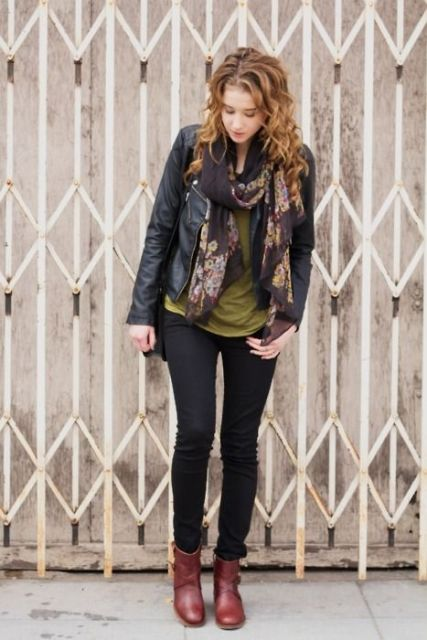 With olive green shirt, black pants, brown leather boots and black leather jacket