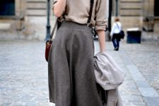 With oversized shirt, jacket, leather bag and lace up mid calf boots