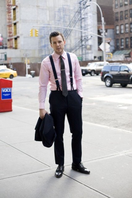 With pale pink shirt, black tie, black pants and shoes