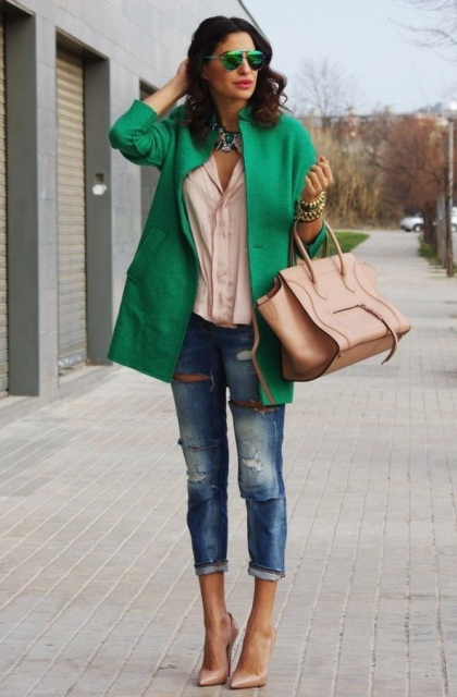With pastel colored shirt, green jacket, cuffed jeans and beige bag