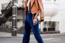 With platform shoes and brown leather jacket