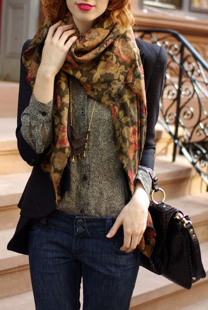 With printed blouse, jeans, black blazer and bag