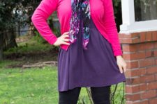 With purple dress, black tights, black high boots and pink cardigan