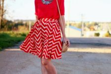 With red shirt, necklace, black flats and brown small bag