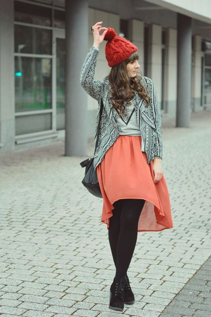 With shirt, printed blazer, beanie, black tights, ankle boots and black bag