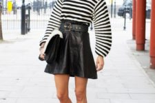 With striped shirt, leather skirt and clutch
