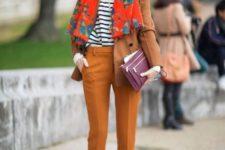 With striped shirt, orange crop pants, black heels, brown blazer and purple clutch