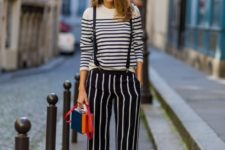 With striped shirt, red pumps and red and blue bag