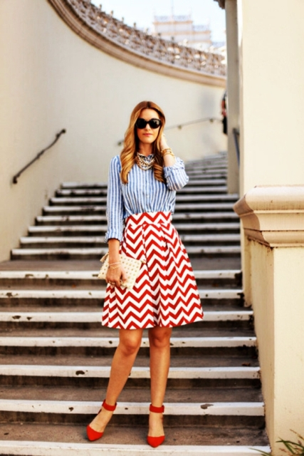 With striped shirt, red shoes and clutch