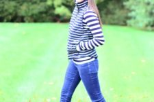 With striped shirt, skinny jeans and brown ankle boots