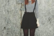 With striped shirt, wide brim hat and flat boots