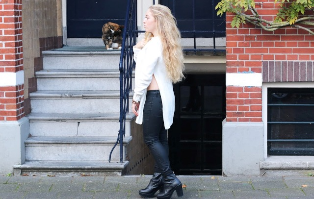 With trousers and black leather boots