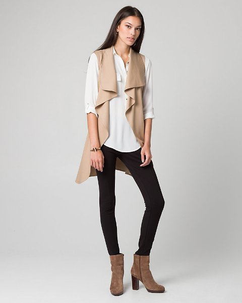 With white blouse, leggings and brown suede boots