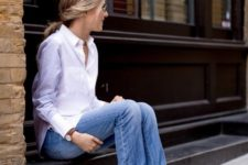 With white button down shirt and cuffed jeans