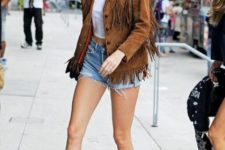 With white crop t-shirt, denim shorts and velvet boots