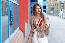 With white dress and golden and red clutch