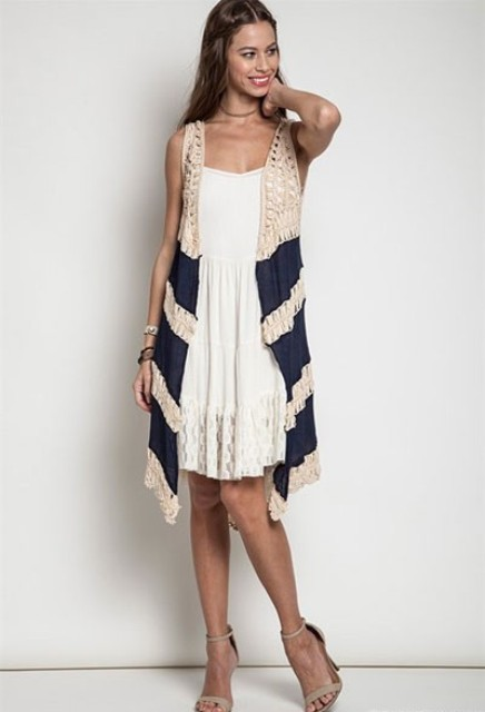 With white lace dress and beige sandals