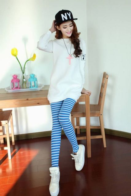 With white long sweater, cap and white sneakers