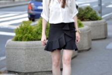 With white shirt and black pumps