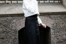 With white shirt and midi skirt