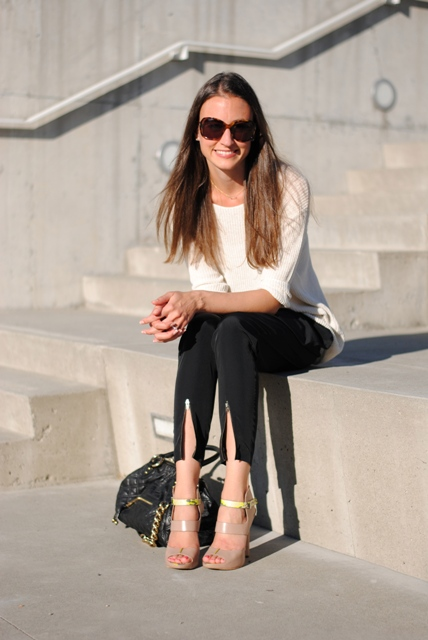 With white shirt, beige and yellow sandals and black bag