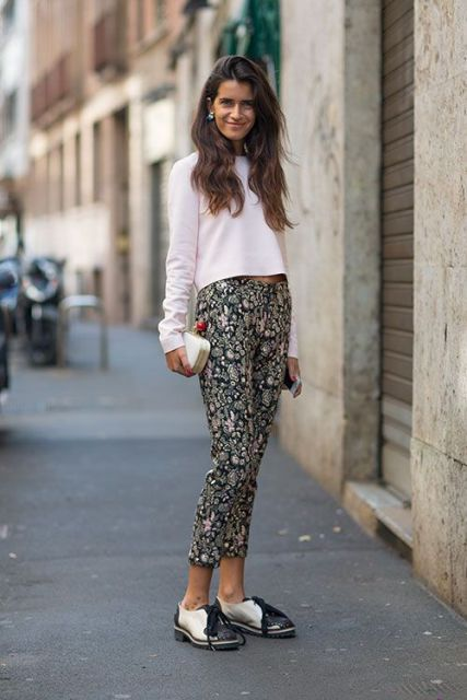 With white shirt, black and white flat shoes and clutch