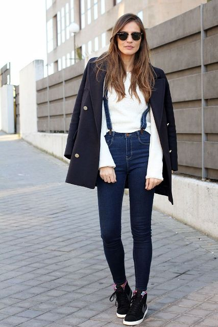 With white shirt, black and white sneakers and black coat