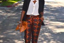 With white shirt, black blazer, orange clutch and heels