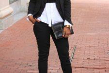 With white shirt, black crop shirt, black blazer, pumps and clutch