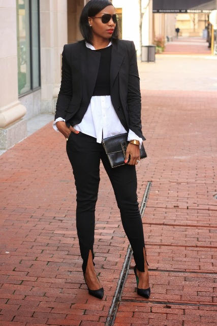 With white shirt, black crop shirt, black blazer, pumps and clutch