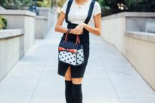 With white shirt, black knee socks, emerald shoes and printed bag