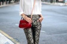 With white shirt, black pumps and red bag