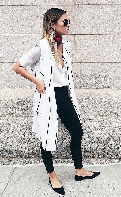 With white shirt, black skinny trousers, flats and printed scarf