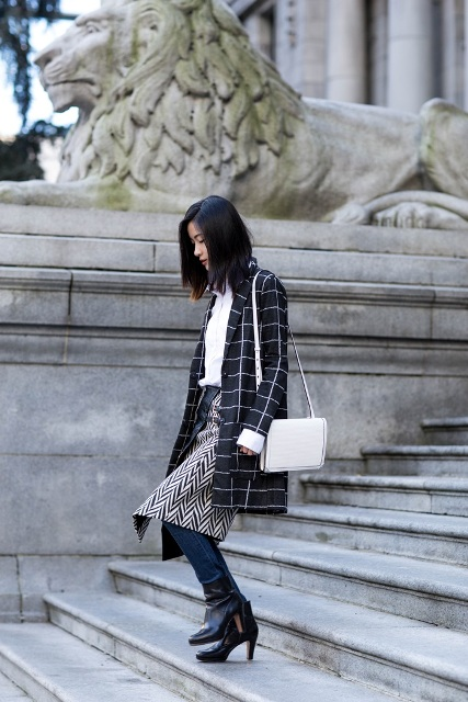 With white shirt, checked coat, jeans, black ankle boots and white bag