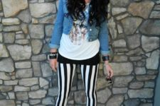 With white shirt, crop denim jacket and lace up boots