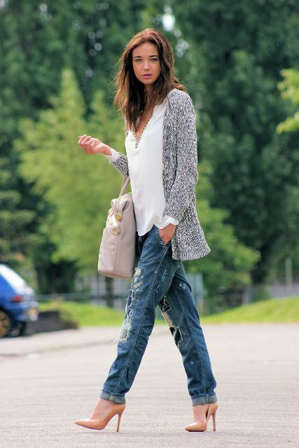 With white shirt, gray cardigan, distressed jeans and tote