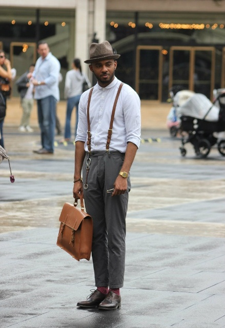 With white shirt, gray pants, brown shoes, brown bag and felt hat